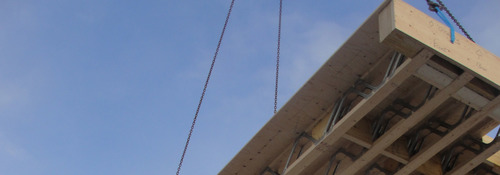 Timber Frame open web floor being lowered into position