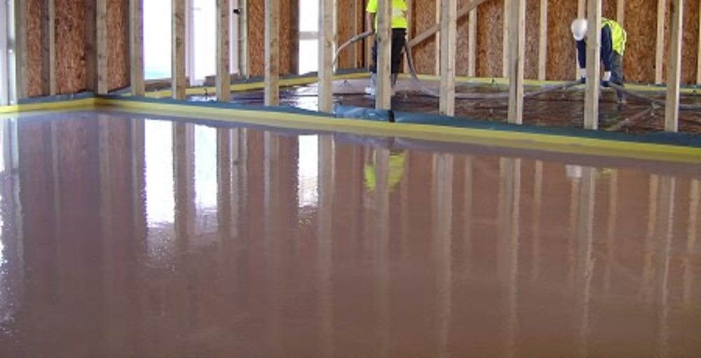 Concrete floor screed being poured