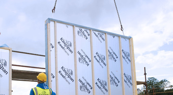 Kingspan's Timber Frame ULTIMA Wall panel being lowered into position by crane